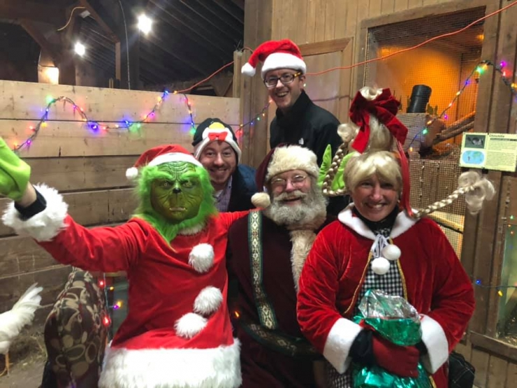 The Grinch & Santa had a blast with some Zoo Board Members.
